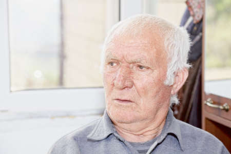 hoary: Portrait of old serious hoary man looking sideways Stock Photo