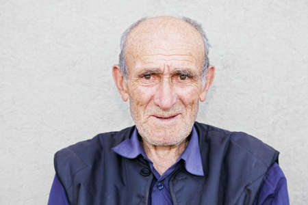 Portrait of smiling old hoary man in blue shirt photo