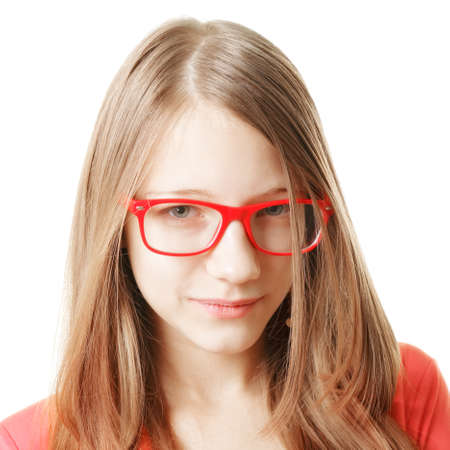 Serious teenage girl in red eyeglasses photo