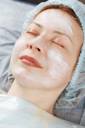 Redhead caucasian woman before face massage eyes closed photo
