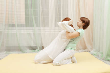 Yumeiho therapy procedure in gym on the yellow mat photo