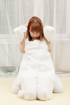 Redhead woman at Yumeiho therapy procedure photo