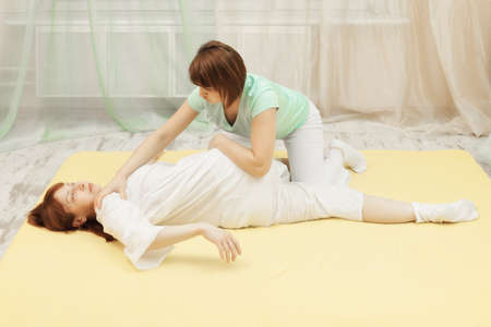 Masseur does Yumeiho therapy to middle-aged caucasian woman