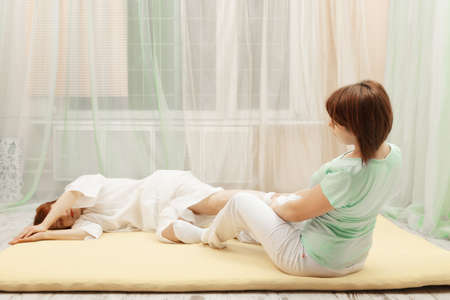 Stretching exercise in Yumeiho therapy procedure photo