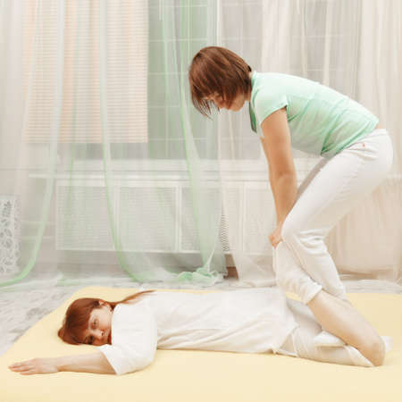 Legs exercise in Yumeiho therapy made to redhead woman photo