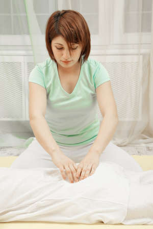 Back massage in Yumeiho therapy made by young woman photo