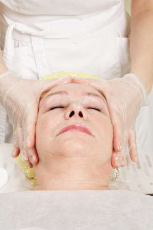 Caucasian senior woman enjoying facial massage Stock Photo - 18713787