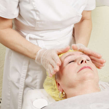 Caucasian elderly woman enjoying facial massage Stock Photo - 18713785