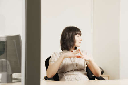 Businesswoman looking sideways while sitting at the desk in office Stock Photo - 18960952