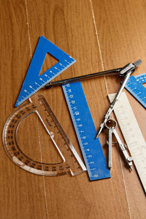 metering: Drawing set over wooden surface