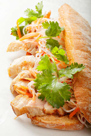 mi: Traditional hot vietnamese banh mi sandwich with pork and greens