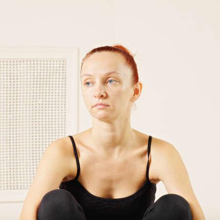 looking sideways: Portrait of tired redhead woman looking sideways