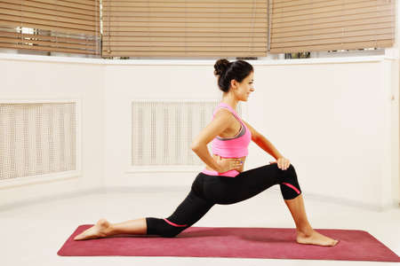 contented: Contented brunette woman at stretching yoga pose