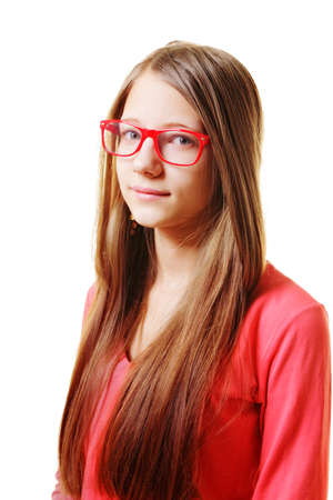 Serious teenage girl in red sweater against white photo