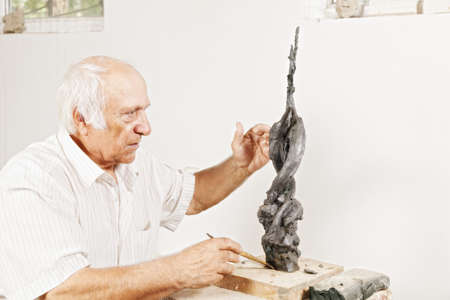 Sculptor tells about his sculpture in a workshop photo