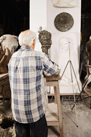 Sculptor rear view workshop scene photo