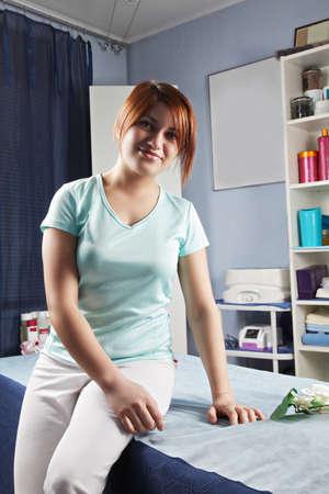 pleasant emotions: Redhead caucasian masseur sitting on massage couch