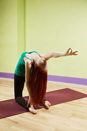 stretched out: Backbend yoga position with hand stretched out