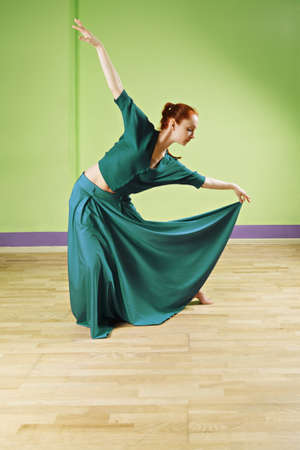 reverence: Caucasian redhead woman making bow while dancing