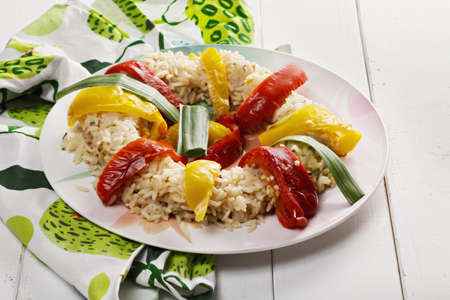 ovenbaked: Risotto with oven-baked bell peppers on a white wooden tabletop Stock Photo