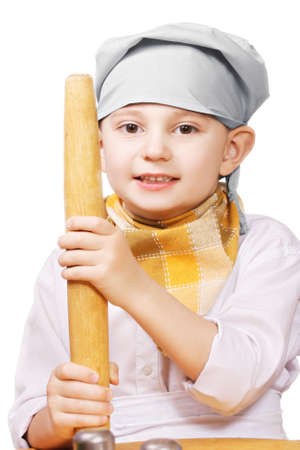 pleasant emotions: Little cook with rolling pin against white background