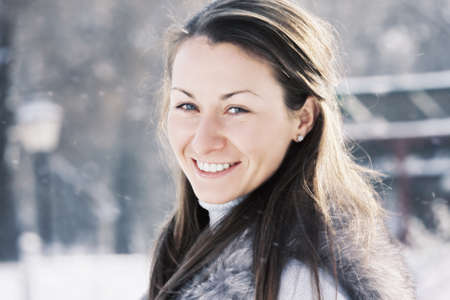 pleasant emotions: Smiling young caucasian woman outdoors in a winter day