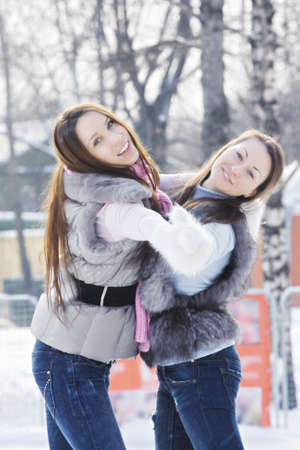pleasant emotions: Women dancing while skating on ice rink outdoors Stock Photo