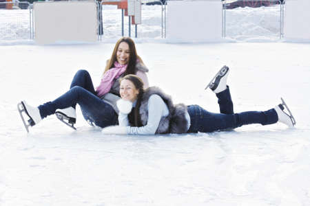 pleasant emotions: Two positive women on ice outdoors