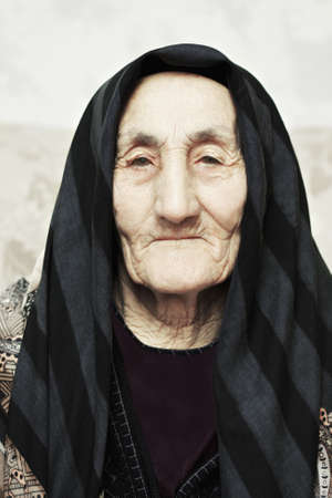 Serious elderly caucasian woman closeup portrait photo