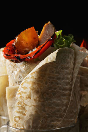burrito: Buritto with rice and roasted chicken in darkness closeup