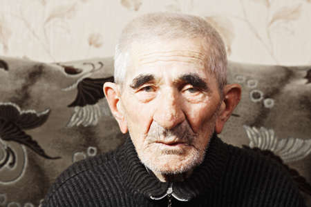 grayness: Portrait of serious caucasian elderly man