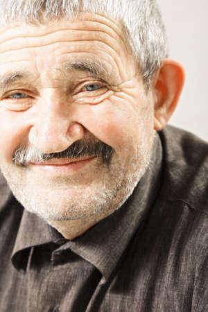 hoariness: Smiling senior caucasian man closeup photo selective focus