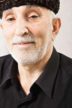 grayness: Elderly bearded caucasian man in fleece hat Stock Photo