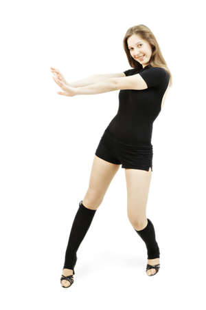 pleasant emotions: Young caucasian female dancer at motion against white