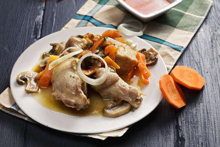 bonne: Braised chicken bonne femme with vegetables on a wooden tabletop