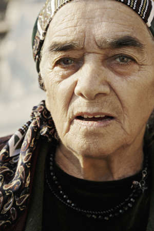 grayness: Closeup portrait of elderly serious caucasian woman