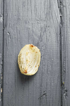 tabletop: Baked onion on a wooden tabletop overhead