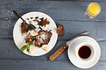 leftovers: Sweet breakfast leftovers on a wooden tabletop overhead Stock Photo
