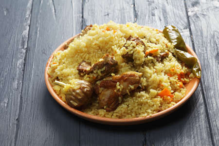 tabletop: Rice pilaf with lamb on a wooden tabletop