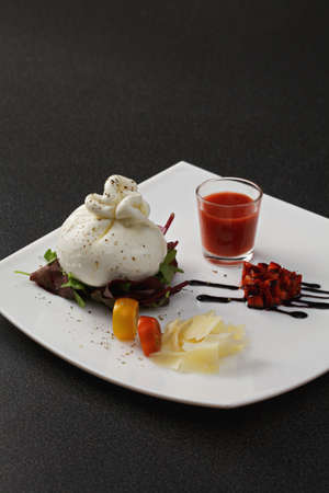 mediterranian: Burrata cheese with gazpacho sauce and tomatoes