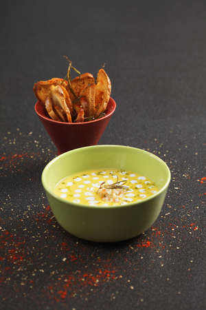 tabletop: Pumpkin soup with shrimps and coconut sauce on a tabletop Stock Photo
