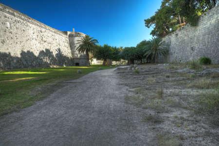 mediaeval: The dusty road among mediaeval city walls Stock Photo