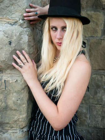 gril: Gothic girl with a black hat Stock Photo
