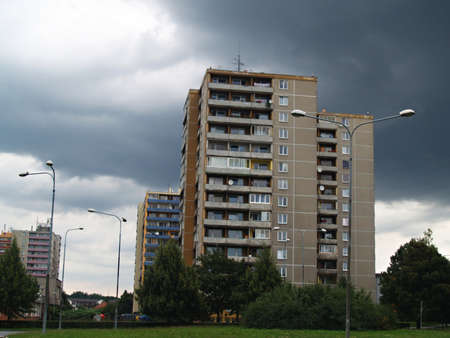 old prefabs and dramatic cloudy sky