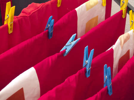 A detail of red hanging laundry Stock Photo