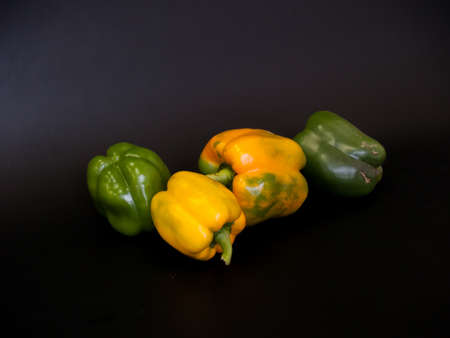 ordinary green and yellow peppers Stock Photo
