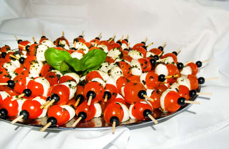 tomatoes with mozzarela on a plate Stock Photo
