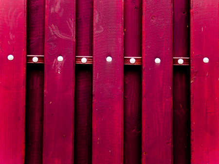 red fence, building detail