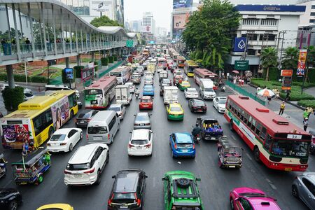 BANGKOK, THAILAND - DECEMBER 25, 2019: Jammed traffic on downtown road in front of Central World mall on holiday season.