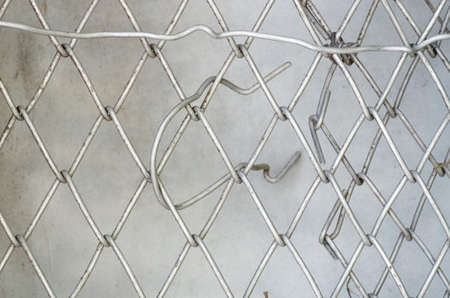 metal net: Texture of wire mesh.Steel grating fence background.Close up Metal net,vintage color.Mesh fence